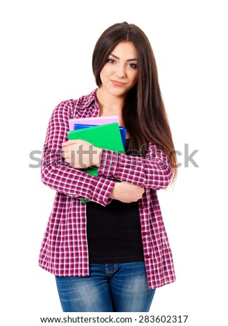 Nice female student with books looking at camera, isolated on white background - stock photo