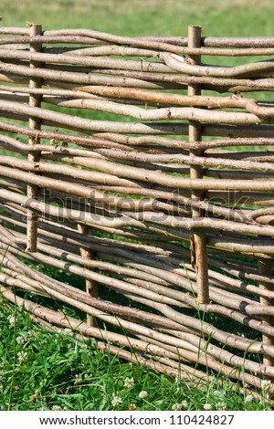 Nice fence in the countryside during the summer - stock photo
