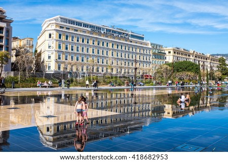 NICE, FRANCE- APRIL 13: Kids are playing in the park of Nice (Miroir d'eau) on April 13, 2016 in Nice, France. Nice is a city located on the French Riviera - stock photo