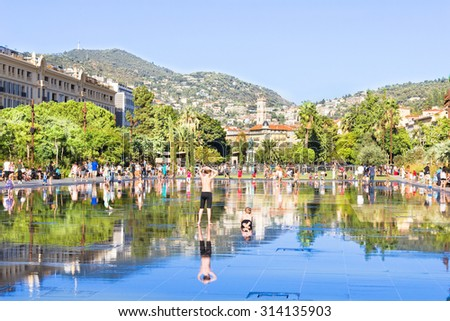 NICE, FRANCE - AUGUST 23, 2015: Fontaine on Place Massena in Nice. The square is a modern part of the city and the contains several attractions, stores and arts. - stock photo