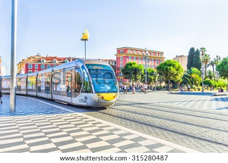 NICE, FRANCE - AUGUST 21: Tourists walking in the Place Massena, on August 21, 2015 in Nice, France. The place is the most famous of the city because of its beauty, shopping options and the carnival. - stock photo