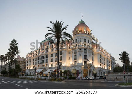 NICE, FRANCE - CIRCA JULY 20: Negresco hotel is a luxury hotel containing 121 rooms and 24 suites, located on the Promenade des Anglais in Nice, a symbol of the Cote d'Azur. - stock photo