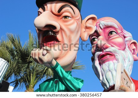 Nice, France - February 21 2016: Caricature of Charles de Gaulle and Moses (Prophet). Charles de Gaulle was a French General. Parade Float during the Carnival of Nice 2016 in French Riviera - stock photo