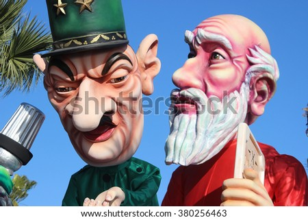 Nice, France - February 21 2016: Caricature of Charles de Gaulle and Moses (Prophet). Charles de Gaulle was a French General. Parade Float during the Carnival of Nice in French Riviera - stock photo