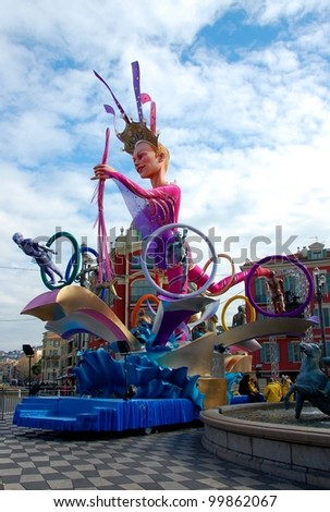 NICE, FRANCE - FEBRUARY 21: Carnival of Nice in French Riviera. This is the main winter event of the Riviera. 2012 theme is the King of Sport. Carnival queen composition. Nice, France - Feb 21, 2012 - stock photo