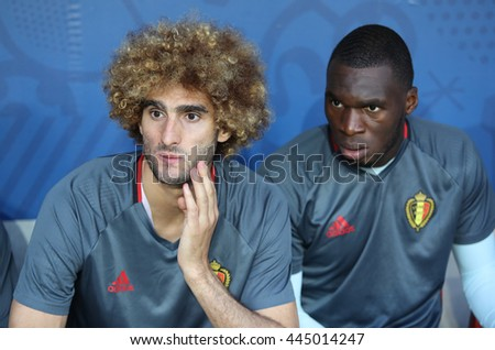 NICE, FRANCE - JUNE 22, 2016: Marouane Fellaini (L) and Jordan Lukaku of Belgium look on before the UEFA EURO 2016 game against Sweden at Allianz Riviera Stade de Nice, City of Nice, France - stock photo