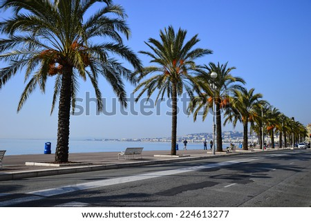 NICE, FRANCE - MARCH 13, 2014: People enjoy walks and jogging on the Promenade des Anglais year round. Built in the 1820'??s it is one of the city's main attractions. - stock photo