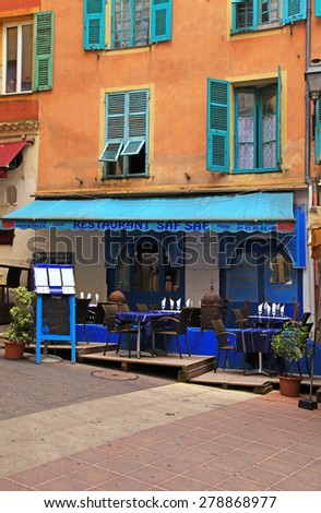 NICE, FRANCE - MAY 14, 2013: Multicolored house and oriental ethnic restaurant in the Old town Nice - the largest resort and tourist town on the French Riviera, Cote d'Azur, France. Vertical image - stock photo