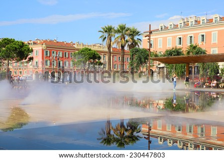 Nice, France - October 08, 2014: Promenade du Paillon at sunny day on October 08, 2014 in Nice, France.  Water springing up at the fountain surrounded by beautiful historic buildings  - stock photo