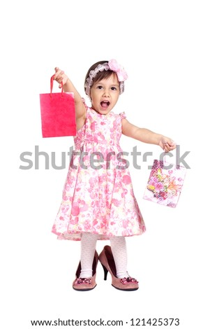 nice girl in a dress stands on a white - stock photo