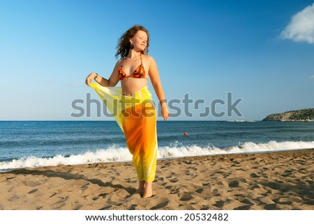 Nice girl relaxing on beach at morning - stock photo