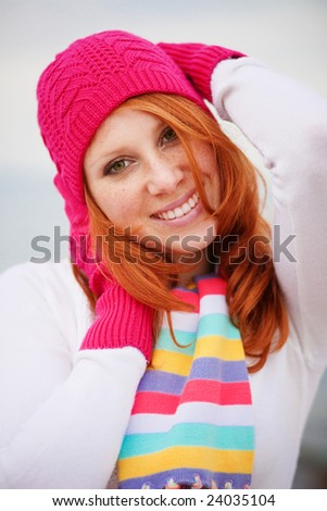 Nice girl wearing vibrant winter clothing - stock photo