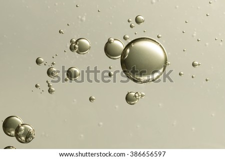 Nice golden champagne bubbles soars over a blurred background - stock photo