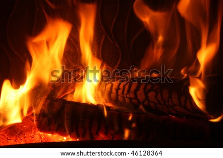 nice home fire in the fireplace, home photo - stock photo