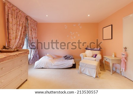 Nice house interior, comfortable bedroom - stock photo