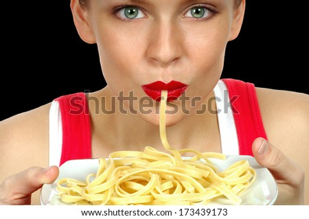 Nice Image of a Beautiful Woman Eating Pasta on Black - stock photo
