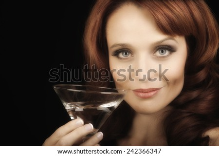 Nice Image of a Woman with a martini - stock photo