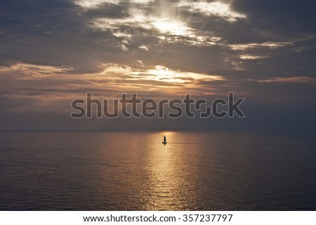 Nice little boat at down - stock photo