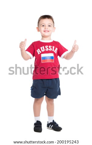 Nice little boy posing in Russian football uniform. Isolated on white - stock photo