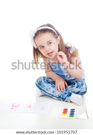 nice little girl drawing with watercolor paint and brush - stock photo
