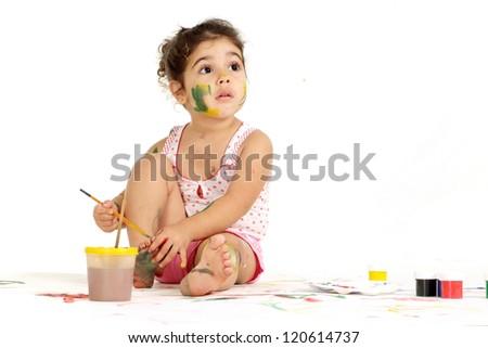 nice little girl draws on the floor - stock photo