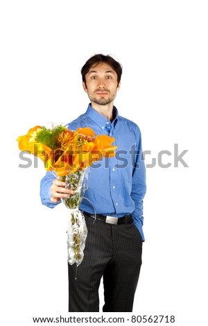 nice man in a blue shirt with orange bristles standing with a bunch of flowers and smiling - stock photo