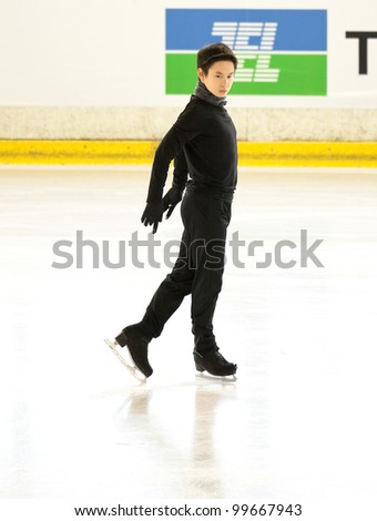 NICE - MARCH 28: Denis Ten of Kazakhstan skates during official practice at the ISU World Figure Skating Championships, held on March 28, 2012 in Nice, France - stock photo