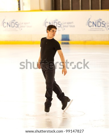 NICE - MARCH 26: Javier Fernandez of Spain skates during official practice at the ISU World Figure Skating Championships, held on March 26, 2012 in Nice, France - stock photo