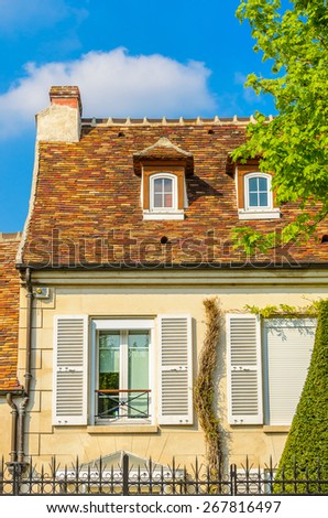 Nice mediterranean house facades roofs and windows with different colours - stock photo