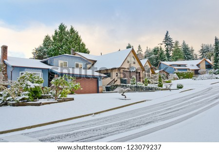 Nice neighborhood in cold,chilly and frosty winter time covered with snow . Vancouver, Canada. - stock photo