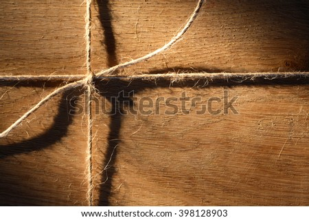 Nice oak timber tied with rope. Wooden background - stock photo