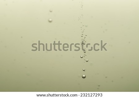 Nice oxygen bubbles in a golden champagne - stock photo