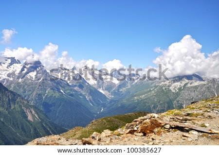 Nice panoramic view of high mountain Dombaj. Russia - stock photo