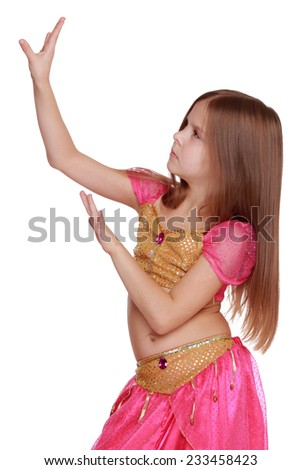 Nice portrait of beautiful long hair blonde woman in pink arabic dance costume/Young Caucasian belly dancing girl in beautiful decorated clothes on white background - stock photo