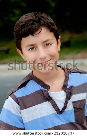 Nice preteen boy smiling with a striped shirt - stock photo