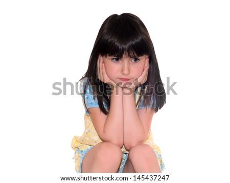 Nice pretty sad girl sitting isolated on white - stock photo