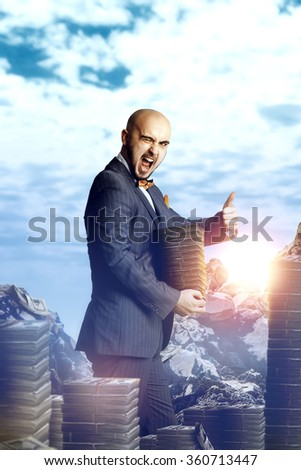 Nice rich man in an expensive suit with a bunch of money around and in the hands. Business concept - stock photo
