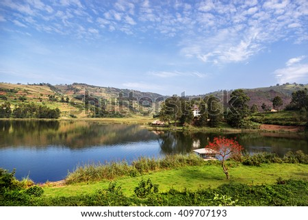 Nice scenario, blue sky day, blue lake, lots of tropical forest in southern Uganda. - stock photo