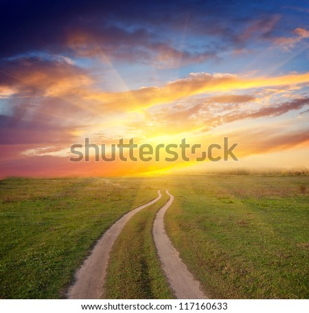 Nice scene with path in steppe to sunset - stock photo