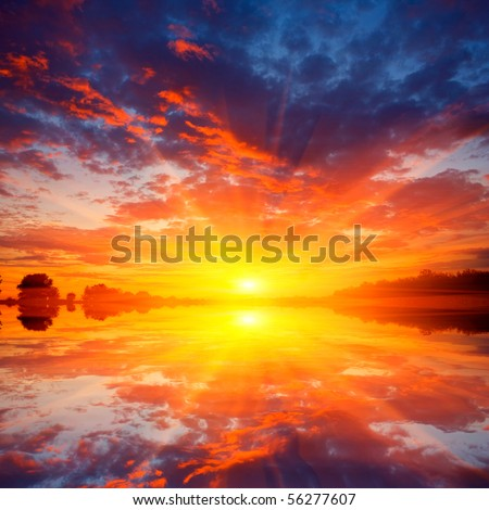 Nice scene with sunset over water - stock photo