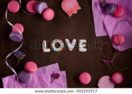 """Nice set of bakery for beloved one to express hidden feelings. Delicious macarons from France and ginger cookies. Special four cookies form a word """"love"""". Nice way to say you love someone.  - stock photo"""