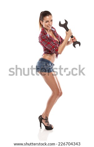 Nice sexy woman mechanic holding wrench isolated over white background - stock photo