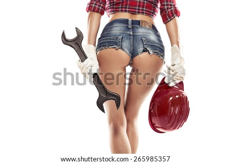 Nice sexy woman mechanic showing  bum buttock  and holding wrench isolated over white background - stock photo