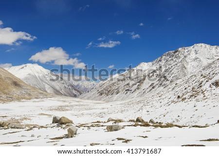 Nice sky with snow hill at Leh Ladakh, India - stock photo