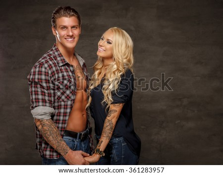 Nice smiling couple of athletic man and slim blond woman. - stock photo