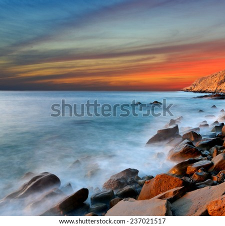 Nice sunset landscape on sea shore - stock photo