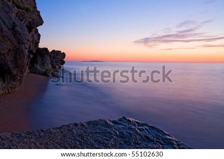 nice sunset on sea shore - stock photo