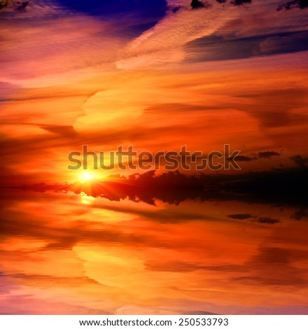 nice sunset over lake water - stock photo