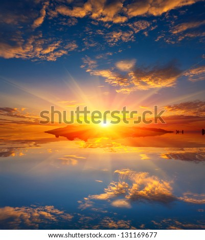 Nice sunset over water surface - stock photo