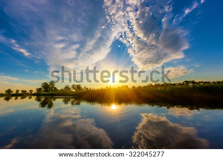 Nice sunset scene over river - stock photo